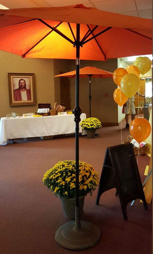 All in Youth conference entry orange umbrella