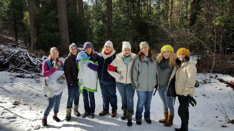 Snowshoeing girls on path