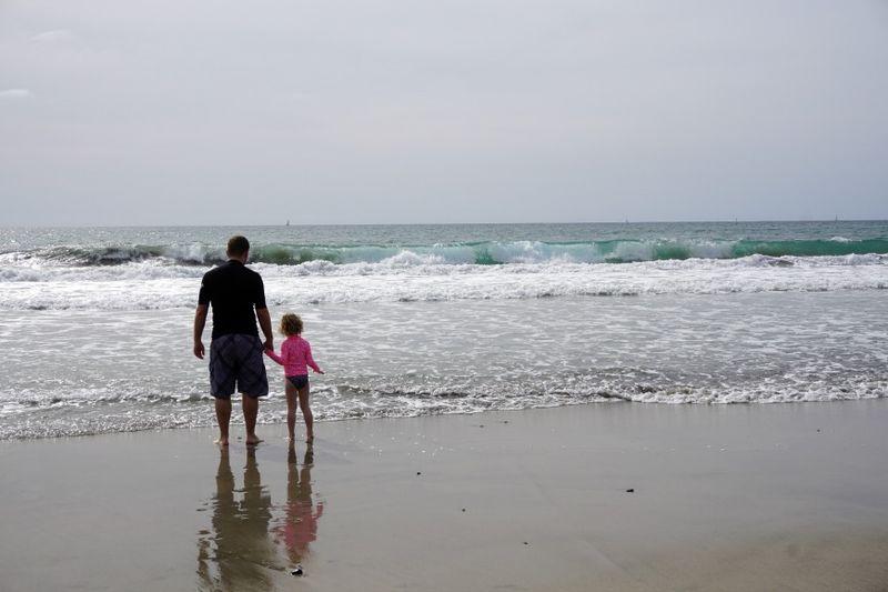 Oceanside168 kent and ellie holding hands