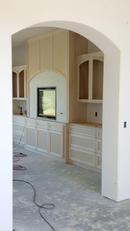 Poppy hill - cabinets kitchen fireplace wall