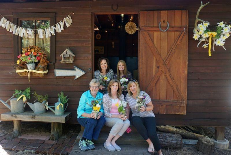 Cabin daffodil day girls on step