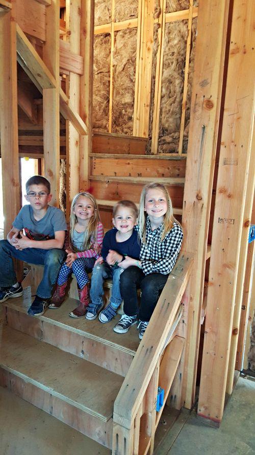 Poppy hill grandkids on stairs