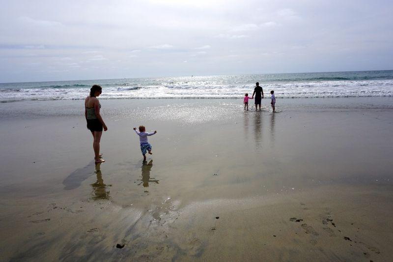 Oceanside186 christian walking on beach