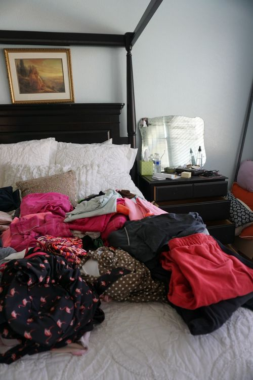 Make room for what you love- clothes on bed